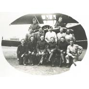 Royal Flying Corps Mechanics, Hainault Farm, about 1917. This photograph belonged to F.W. Perfect, shown front row, far left. © Redbridge Information & Heritage P151.
