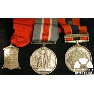 Ilford Fire Brigade medal (left) for air raid duties awarded to C.A Russell, 1919. © Redbridge Museum 1996.100