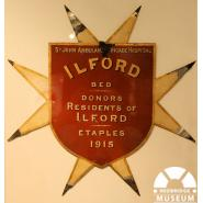 Ilford Bed Plaque, 1915. © Redbridge Museum 1996.278. This plaque comes from St John's Hospital, Étaples, France, which was close to the frontline. In March 1915, members of Ilford St. John Ambulance Brigade organised a street collection to raise £100 to sponsor an 'Ilford Bed' at the hospital, which treated 35,000 patients during the war. It is not known how the bed plaque came back to Ilford after the war.